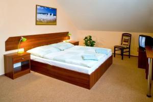 Postel nebo postele na pokoji v ubytování Pension u Svateho Jana
