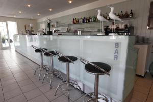 The lounge or bar area at Nymindegab Kro