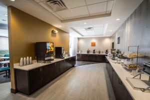 A kitchen or kitchenette at Comfort Suites Fort Lauderdale Airport South & Cruise Port