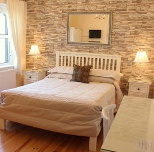 A bed or beds in a room at The Cove Lodge