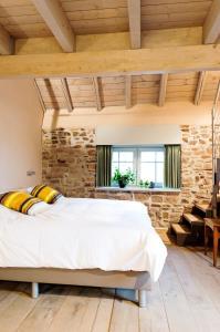 Ein Bett oder Betten in einem Zimmer der Unterkunft Feuerhart