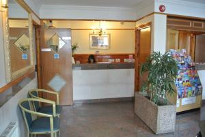 The lobby or reception area at Carlton Hotel