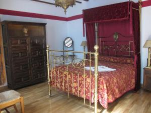 Uma cama ou camas num quarto em Casa Rural Cuatro de Oros
