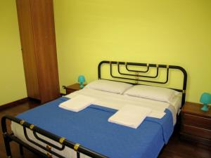 A bed or beds in a room at Star Hostel