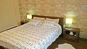 A bed or beds in a room at Apartment Lux Center