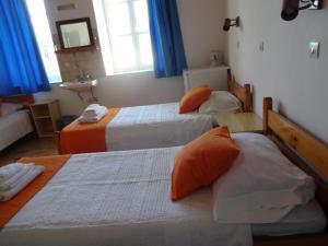 Ένα ή περισσότερα κρεβάτια σε δωμάτιο στο Medieval Rose Hotel
