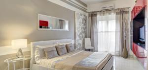 Letto o letti in una camera di SuiteHome Taormina