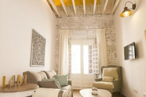 A seating area at Living4Malaga Boutique Apartments