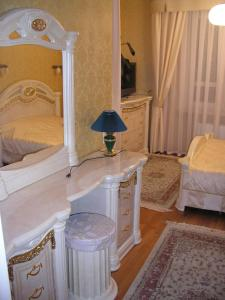 A bed or beds in a room at Aqua Vita - Zhyva Voda
