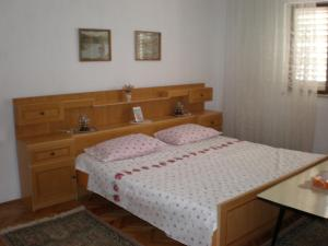 A bed or beds in a room at Apartments Terezija