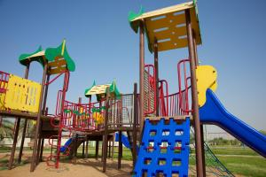 Children's play area at Green Mubazzarah Chalets