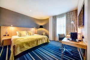 Кровать или кровати в номере Apex City of Edinburgh Hotel