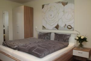 Ein Bett oder Betten in einem Zimmer der Unterkunft Pension Landart