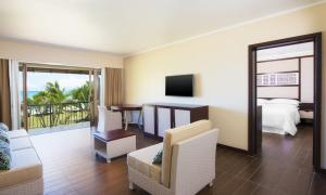 A television and/or entertainment center at Sheraton Samoa Beach Resort