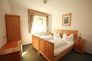 Postel nebo postele na pokoji v ubytování Appartements Dachsteingasse by Schladming-Appartements