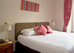 A bed or beds in a room at New Dungeon Ghyll Hotel