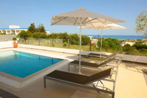 Gennadi Aegean Horizon Villas tesisinde veya buraya yakın yüzme havuzu