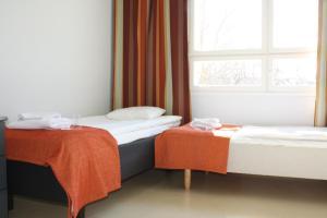 Säng eller sängar i ett rum på Summer Hotel Vuorilinna