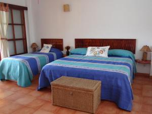 Cama o camas de una habitación en Casa Adriana