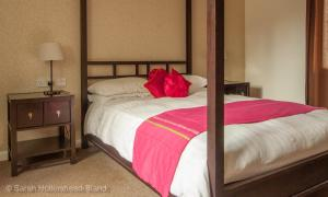 A bed or beds in a room at The Falcon At Hatton