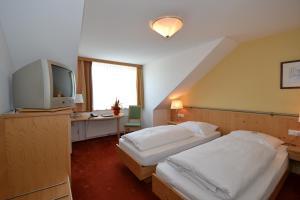 Ein Bett oder Betten in einem Zimmer der Unterkunft Hotel Kohlpeter