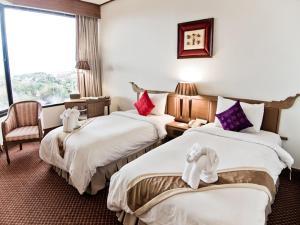 ライトーン ホテルにあるベッド