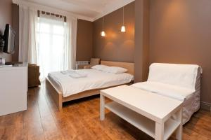 A bed or beds in a room at SweetHotel Vnukovo