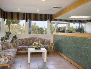 The lobby or reception area at Days Inn by Wyndham Fresno Central
