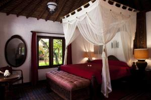 A bed or beds in a room at La Taverna Suites