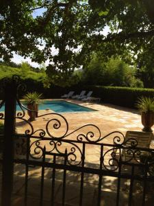 The swimming pool at or near Les Gites du Merle