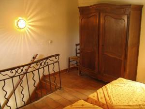 A bed or beds in a room at Les Gites du Merle