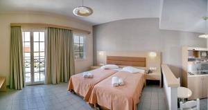 Un ou plusieurs lits dans un hébergement de l'établissement Princess Studios Mitilini