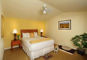 A bed or beds in a room at West Sonoma Inn & Spa