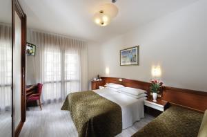 Postel nebo postele na pokoji v ubytování Hotel Eden
