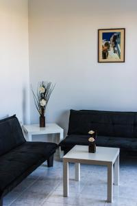 A seating area at Pyrgos Hotel Apartments