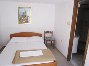 A bed or beds in a room at Apartments Antonia
