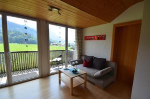 Ein Sitzbereich in der Unterkunft Apartment Magdalena