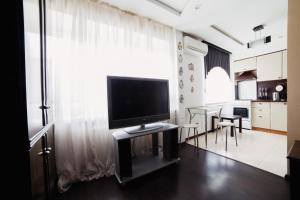 A television and/or entertainment center at Five Stars Sverdlovsky prospect