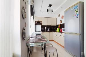 A kitchen or kitchenette at Five Stars Sverdlovsky prospect