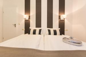 A bed or beds in a room at Appartement-Villa Steinfurth