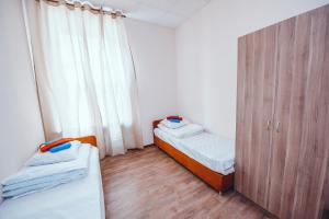 RiverSide Nevsky Hotelにあるベッド