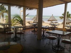 A restaurant or other place to eat at Coeur Sénégal