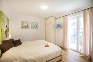 A bed or beds in a room at Haus Wasmer by AlpenTravel