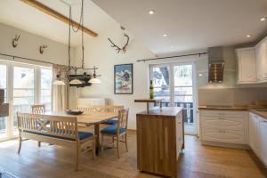 A kitchen or kitchenette at Haus Wasmer by AlpenTravel