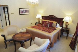 A bed or beds in a room at Kilronan Castle Hotel & Spa