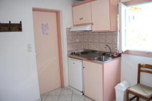 A kitchen or kitchenette at Studios Naxos