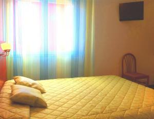 Een bed of bedden in een kamer bij Résidence du Soleil