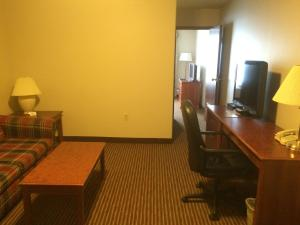 A television and/or entertainment center at Foxwood Inn and Suites
