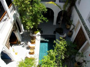 A view of the pool at Riad Les Yeux Bleus or nearby