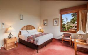 A bed or beds in a room at Asilomar Conference Grounds